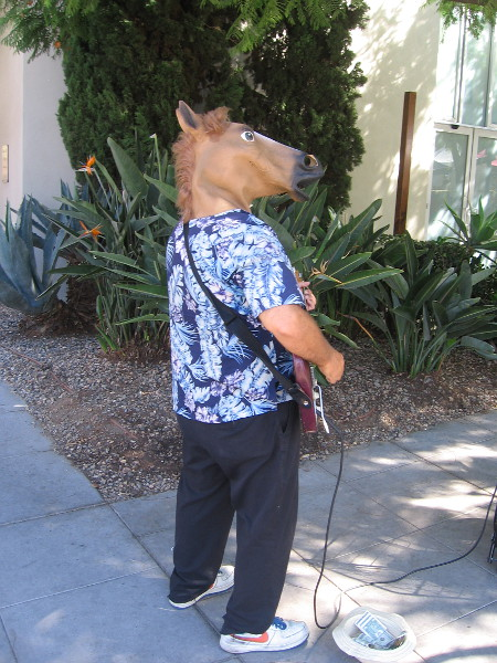 Entertainer with horse head at the Little Italy Farmers' Market.