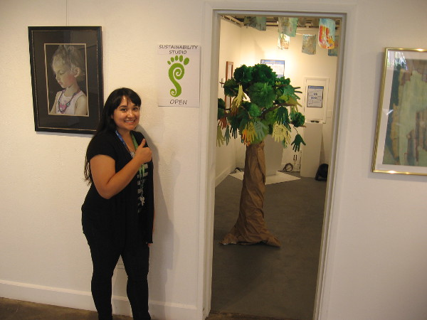Ruby welcomes visitors into the Sustainability Studio, where one can learn about the conservation efforts of various organizations in Balboa Park.