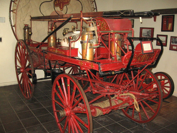 """Old La Jolla"" hand drawn fire engine dating from 1886, on display at The San Diego Firehouse Museum."