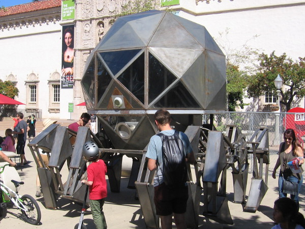 A huge spider-like working octopod vehicle on display in the Plaza de Panama at 2016 Maker Faire San Diego!