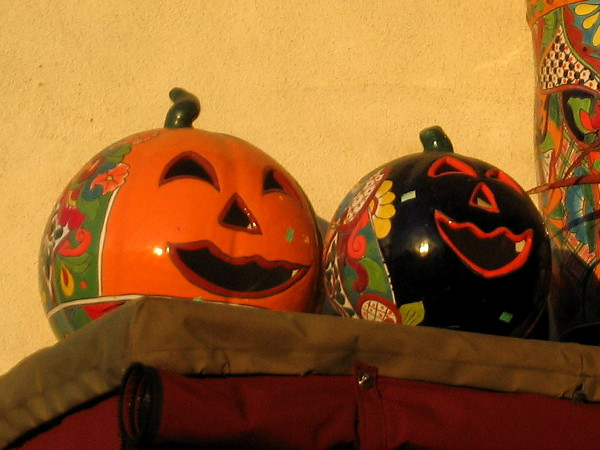Pottery pumpkins smile outside a gift shop in San Diego's festive Old Town.