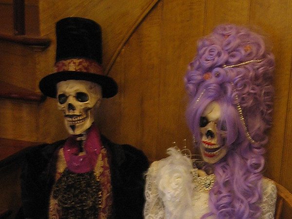 Two elegantly dressed skeletons can be seen seated just inside the front entrance of the Cosmopolitan Hotel in Old Town.