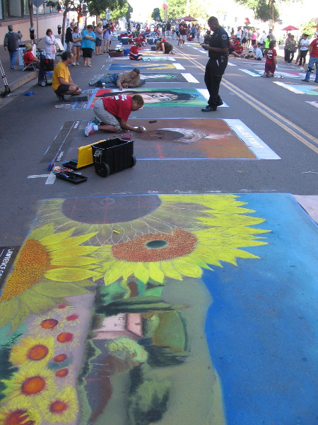 Artists complete their chalk art masterpieces at 2016 Festa in Little Italy.