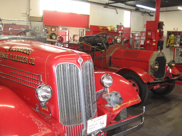 Two vintage fire engines in the old firehouse. The museum's walls are lined with interesting objects that tell the story of firefighting since the mid-1800s.