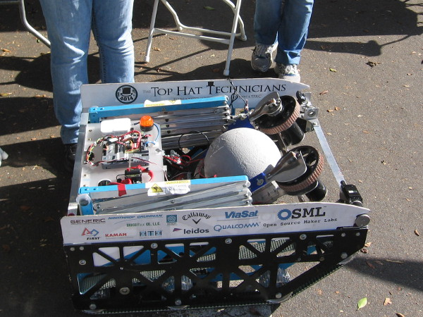This cool robot was created by high school students, namely High Tech High's Top Hat Technicians. It competed in an event where a ball had to be shot at a goal.