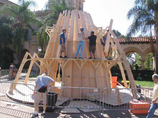 These creators at Maker Faire San Diego were building the Temple for Youtopia. It's an interlocking plywood parabaloid with a single light source at it's focal point.