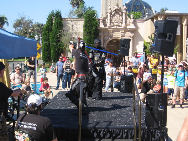 Back in Balboa Park's central Plaza de Panama, the San Diego Sabers engaged in a fast-paced lightsaber battle!