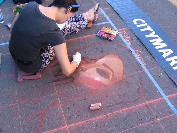 Chalk and asphalt. Passion and skill. A human face is born.