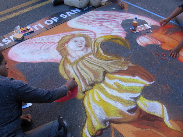 A colorful chalk angel in Little Italy.