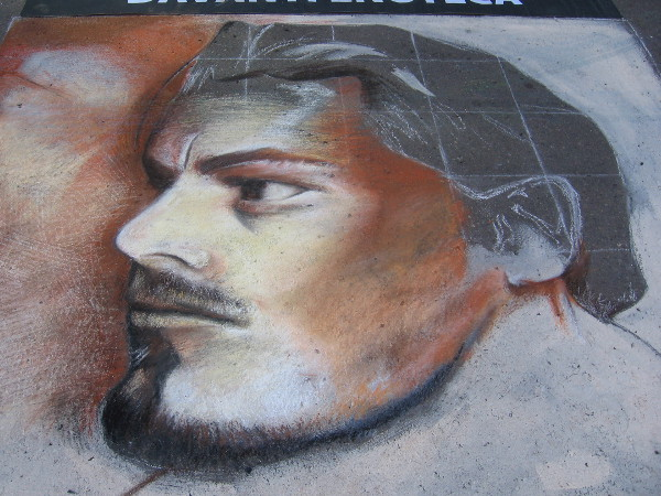 Stan Tang. A strong masculine face drawn with chalk.