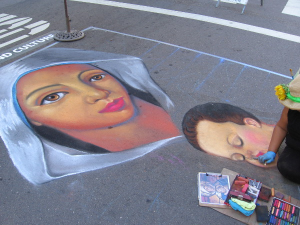 Cecelia Linayao. A mother and child take form on the street at Festa.