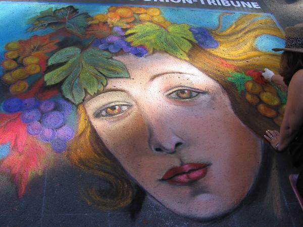 Renee Keady. Grapes crown a beautiful female face.