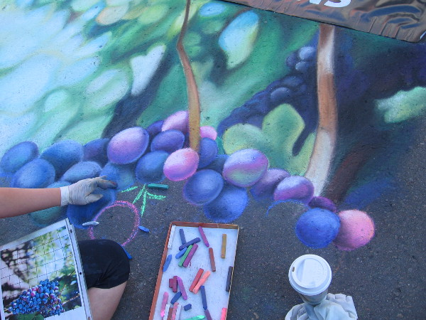 Brianna Cunha. The Italian theme at Festa most certainly includes grapes!