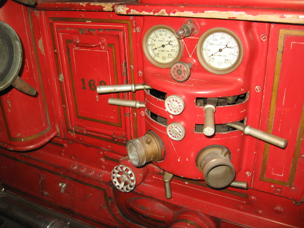 Water pressure controls on the side of one pumper.