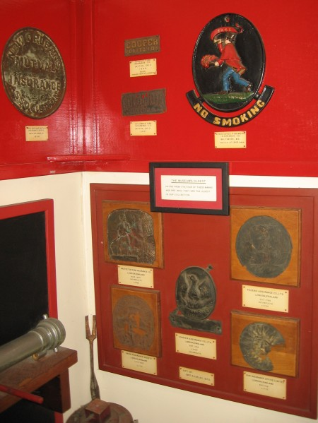 One corner of the Firehouse Museum showcases many old fire insurance marks which were affixed to buildings. One of these marks dates back to 1714.