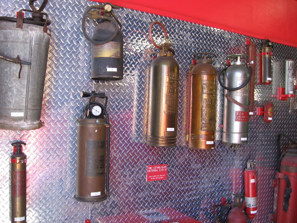 One wall features a collection of old fire extinguishers.