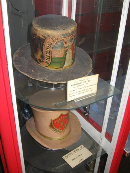 Felt and paper stovepipe hats once worn by firefighters during parades.