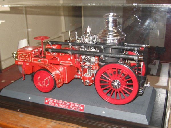 Model of 1899 Metropolitan Steamer with 1911 Christie tractor.