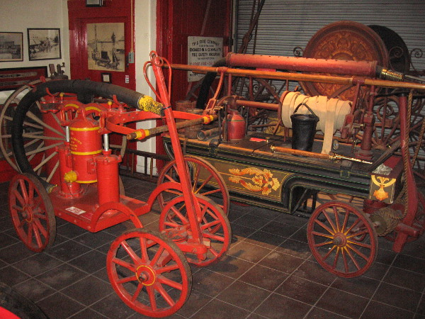 A collection of colorful old hand pumpers at The San Diego Firehouse Museum.
