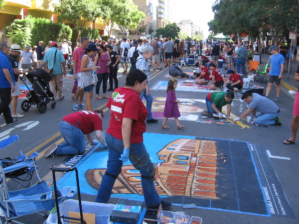 A crowd admires chalk art, or Gesso Italiano, during Festa. The amazing artwork celebrated Italy's history and culture.