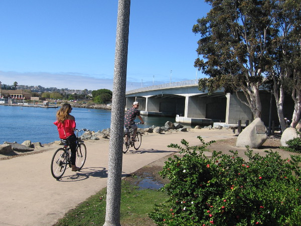 Bicyclists near the west end of Spanish Landing Park. By crossing the North Harbor Drive Bridge, one can enter Point Loma.