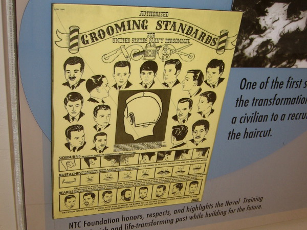 An old poster depicts authorized grooming standards for United States Navy Personnel.