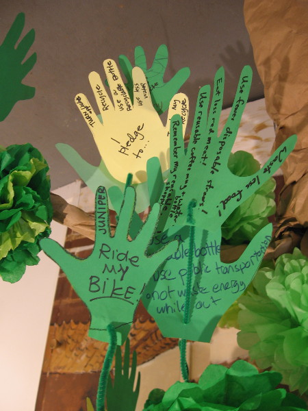 Leaves on the Tree of Change. Kids pledge to ride bikes, turn off lights, recycle, use less water . . .