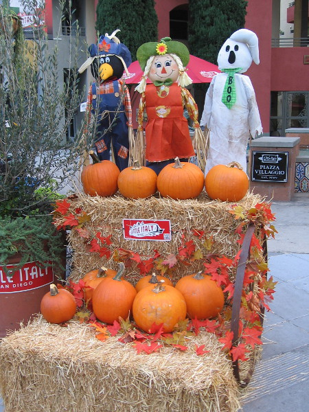 A fun display of pumpkins and Autumn characters on a street corner in Little Italy. Halloween is on the way! Boo!