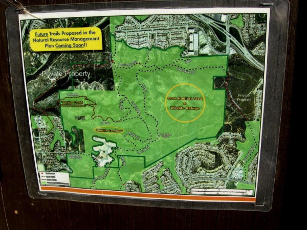 A sign posted at the trailhead shows future trails proposed in the Natural Resources Management Plan.