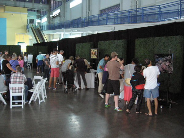 People inside the Port Pavilion learn about science and technology related to the understanding of planet Earth's oceans.