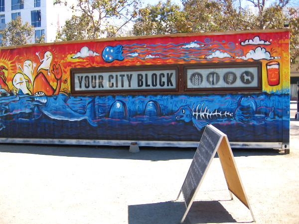 Words on one shipping container at the Quartyard proclaims this is Your City Block.