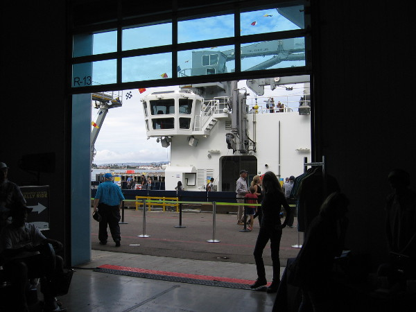 Peering out of the Port Pavilion at the RV Sally Ride, docked at San Diego's Broadway Pier.