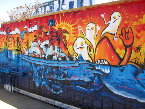 Sun, water, hungry sharks and a tropical island. I'm not exactly sure what is going on in this crazy street art created by Nick McPherson and MR DVICE.