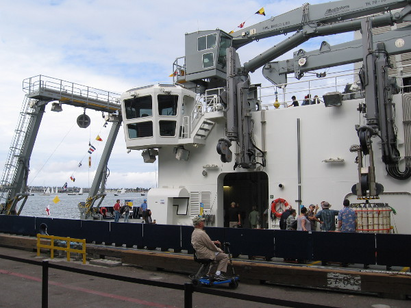 Photo aiming toward the stern of RV Sally Ride. The big A frame, giant crane, and two retractible arms on the starboard side of the ship are visible.