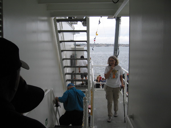 Heading down steep steps to the research ship's fantail and work deck.