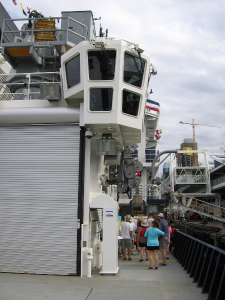 Now we are heading toward the windowed winch shack, along the starboard side of the ship toward the two retractable arms.