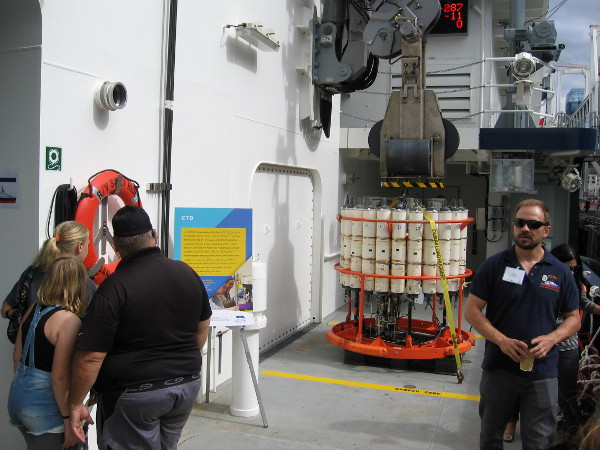 This rosette frame is holding a CTD, or conductivity, temperature and depth sensor. It can be lowered to a depth of nearly 4 miles! Niskin bottles attached to the frame can capture samples to be analyzed on the ship or at a later time.