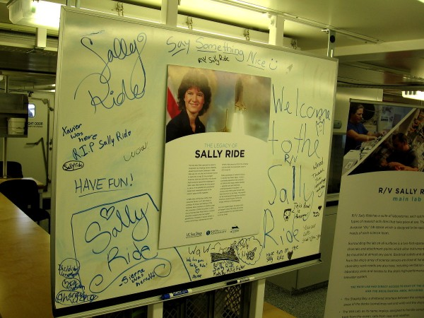 Visitors have written comments near a sign that describes the legacy of Sally Ride, our country's first female astronaut. Sally was on the faculty of UC San Diego.
