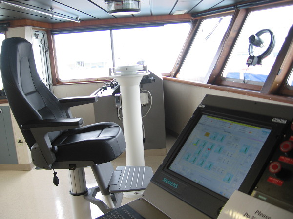 One of the seats where the ship's captain can place himself. When at sea or holding station, a deck officer is present on the bridge at all times.