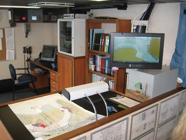 Aft of the starboard side of the bridge is the chart room, where navigational plans are made for each expedition. Old-fashioned maps are still used as an emergency backup!