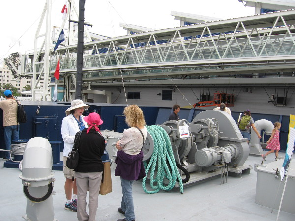 We've arrived at the ship's bow, just below the pilot house, where we find the anchoring station. The big windlass mechanism lowers and raises an anchor.