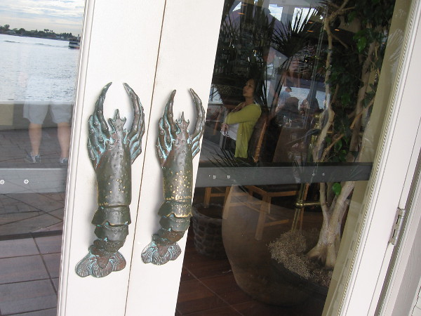 A pair of metal lobster door handles.