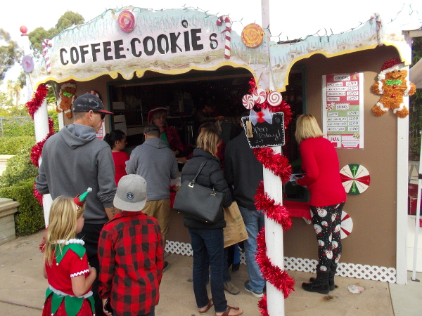 A shack magically transported from the North Pole provides treats at the Spreckels Organ Pavilion during Christmas on the Prado.