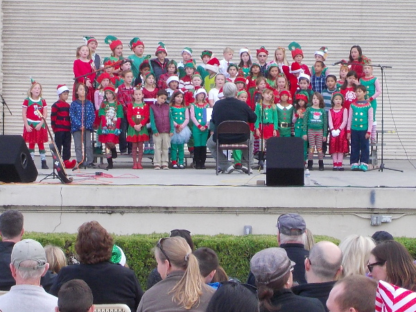 A children's group sings joyful carols and other merry songs during Christmas on the Prado.