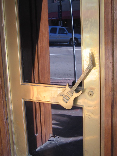 Electric guitar door handle at Hard Rock Cafe in San Diego's Gaslamp.