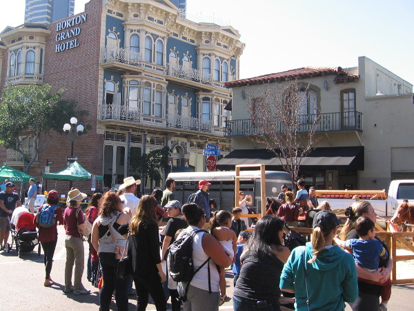 The Horton Grand Hotel rises behind a crowd of people enjoying the 2016 Fall Back Festival, an annual event that celebrates a fascinating period in San Diego history.