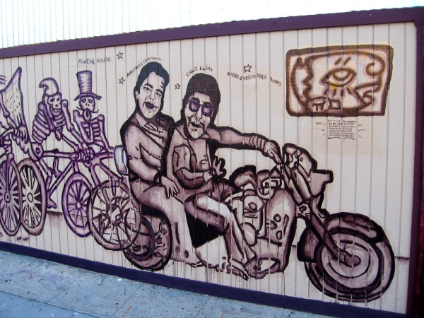 A long mural painted on a building at the corner of National Avenue and Evans Street honors four lives that were lost during a tragic accident in Chicano Park on October 15, 2016.