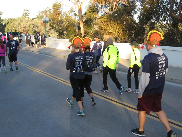 Turkey hats on runners preparing for the Father Joe's Villages Thanksgiving Day 5K, an annual event to help San Diego's homeless.