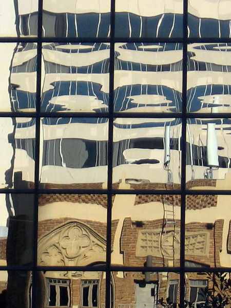 Strangely distorted reflections in the windows of a San Diego high-rise.