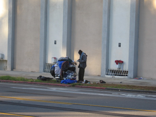Homeless man on Sixth Avenue, across the street from the west edge of Balboa Park.